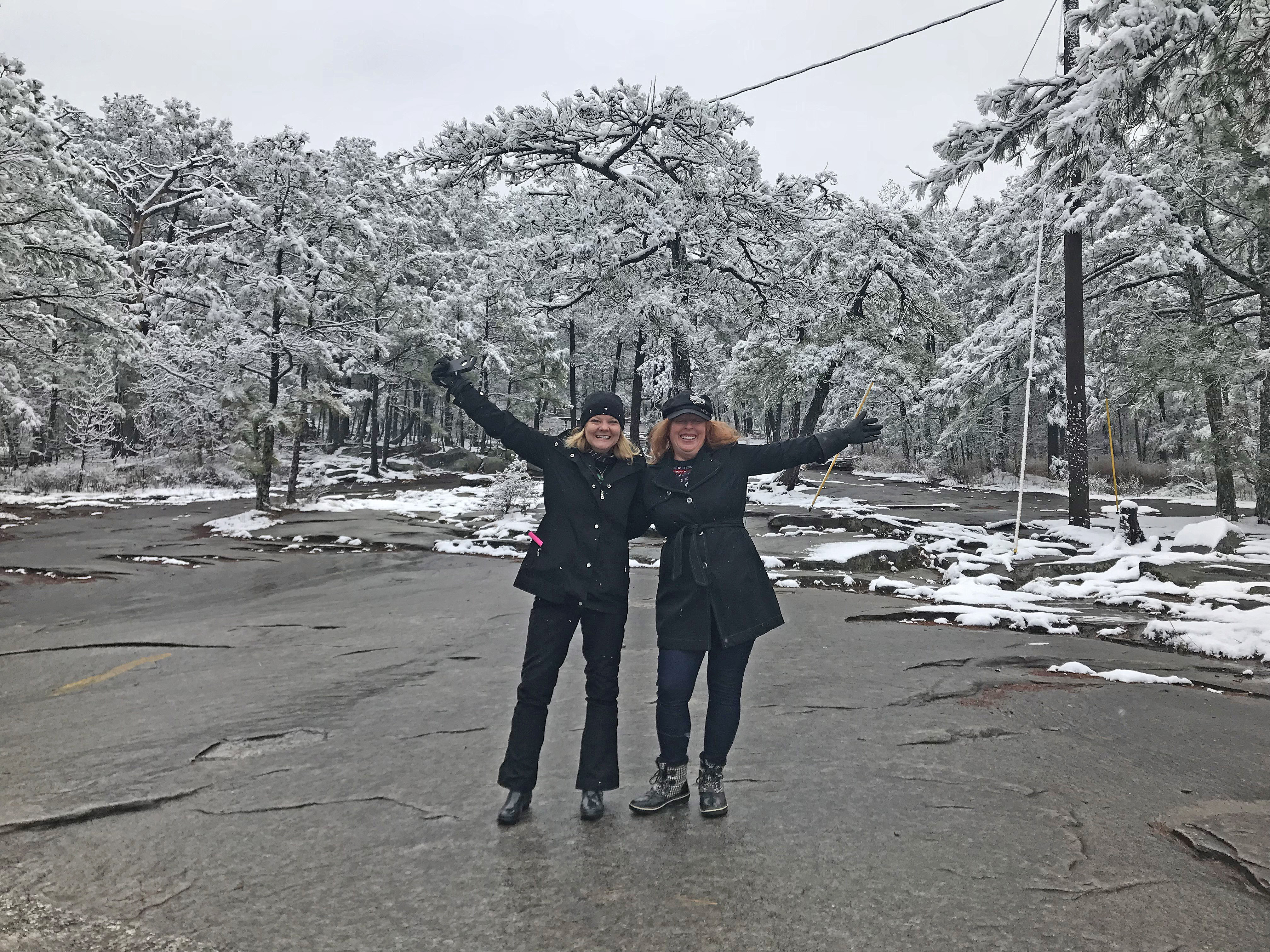 Stone Mountain residents Rhonda Wade and Rose Holland enjoying the snowfall on Stone Mountain on 12-09-17. Afterwards, they went to warm up at Cafe Jaya in Stone Mountain Village.
